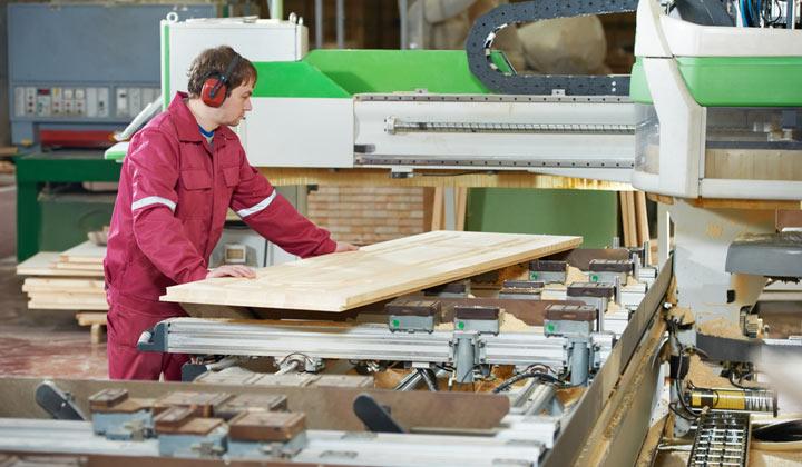 flat wooden board under examination
